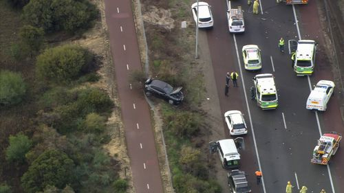 Another vehicle, a Commodore, lost control and swerved off the free, crashing into nearby bushland. Picture: 9NEWS