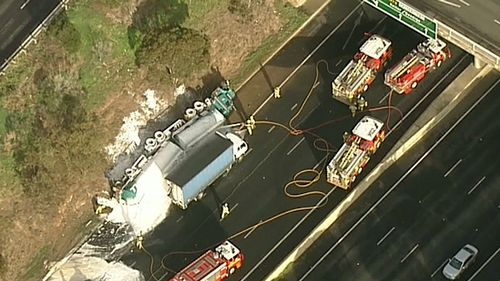 Emergency crews are working to free a trapped car. (9NEWS)