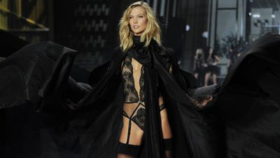 US model Karlie Kloss reveals her dark side on the runway of the Victoria's Secret Fashion Show in London. (AAP)