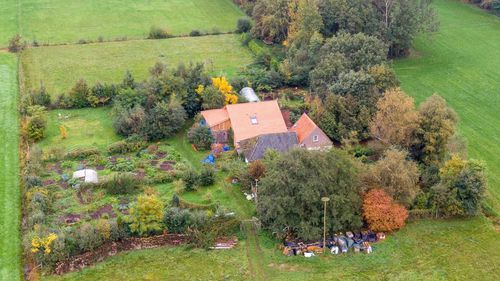 A drone photo of the farm where a father and six children had been living in the cellar.