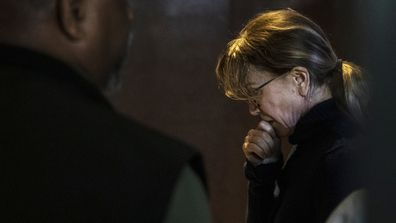 Felicity Huffman looks tired and emotional in court