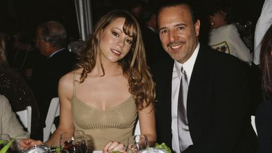 Mariah Carey and husband, American music executive, Tommy Mottola, attend the 'Salute to American Heroes Gala', 1995