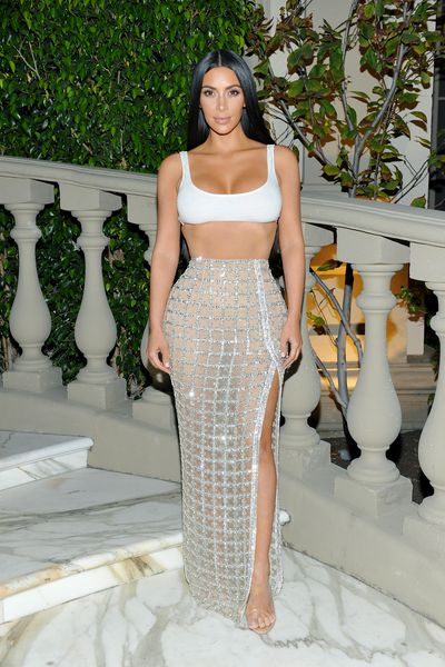 Kim Kardashian is used to baring almost all, here in Balmain at a boutique opening in LA on July 20.