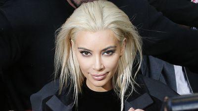 Kim Kardashian has made an impression at Paris Fashion Week sporting platinum blonde locks. (AAP)
