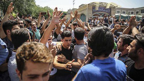 A group of protesters chant slogans at the main gate of the Old Grand Bazaar, in Tehran, Iran (Photo: June 2018)