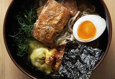 Supernormal ramen with chicken in broth with soy eggs