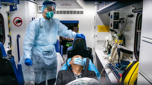 A patient is transferred by an ambulance to the Infectious Disease Centre of Princess Margaret Hospital in Hong Kong, China