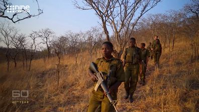 The Akashinga Rangers set off on a night patrol, searching for poachers and protecting local elephant herds.