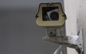 China is installing surveillance cameras outside people's doors and inside their homes