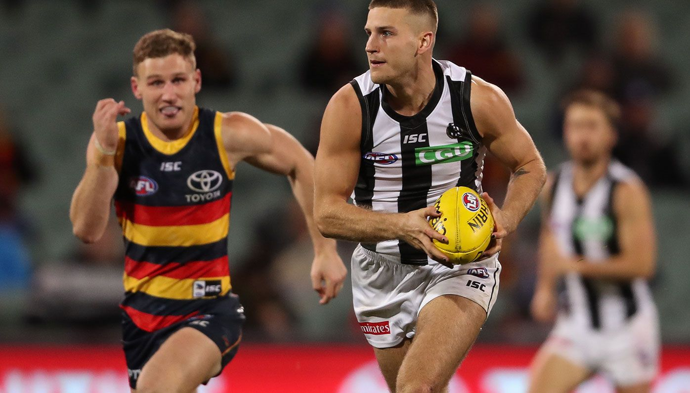 Brayden Sier of the Magpies breaks away from Rory Laird of the Crows.