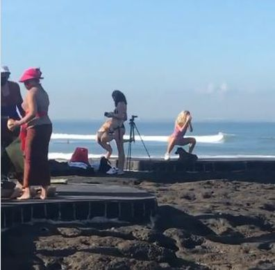 Influencer practises squat routine in Bali to no one's amusement.