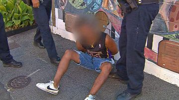 A teenager led police on a chase through Adelaide's main streets after escaping from a patrol car.