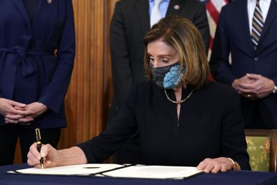 Nancy Pelosi signs article of impeachment