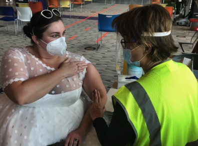 Sarah Study got the coronavirus vaccine in her wedding reception gown