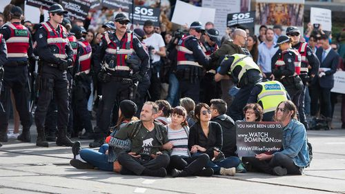 Police move in on animal rights protesters who had blocked the intersections of Flinders and Swanston Street, in Melbourne.
