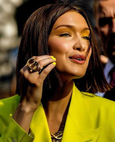 """<p><strong><em>Bella Hadid</em></strong></p> <p>""""These looks can be achieved by using Label.m smoothing cream, blow drying then ironing with GHD platinum irons finished off with Label.m Rejuvenating Radiance Oil for that stunning shine and hydration,""""</p>"""