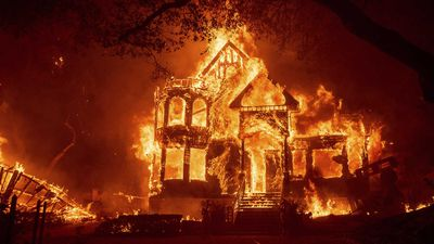 Flames from the Glass Fire consume the Black Rock Inn at St Helena, California.