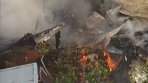 The roof of the home collapsed as the blaze took hold. (Choppercam)