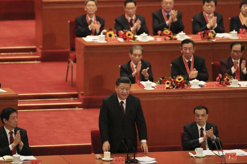 """China's President Xi Jinping finishes his speech during a ceremony to mark the 40th anniversary of China's """"reform and opening up"""" at the Great Hall of the People in Beijing."""