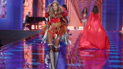 Kate Grigorieva models a racy red outfit in the Victoria's Secret Fashion Show in London. (AAP)