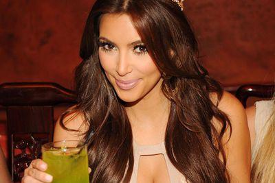 """Aussie, Aussie, Aussie, oi, oi, oi! Last year kinky Kim Kardashian was spotted planting a kiss on her Australian bodyguard, Shengo Deane. The next day, Kim apologized to Shengo, saying she had """"too many drinks last night."""""""