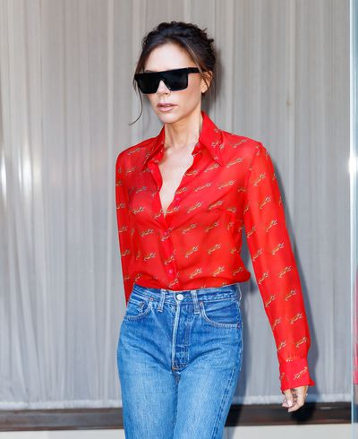 Victoria knows that red can turn the most casual of outfits into head-turning style. See Exhibit A) Above.