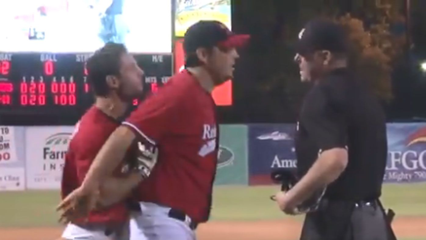 Angry baseball player throws rubbish bin onto field after ejection