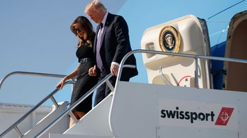 US President Donald Trump disembarks a plane with first lady Melania Trump. (AAP)