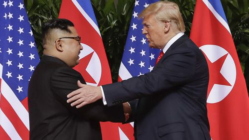 In this June 12, 2018, file photo, U.S. President Donald Trump, right, shakes hands with North Korea leader Kim Jong Un at the Capella resort on Sentosa Island in Singapore.