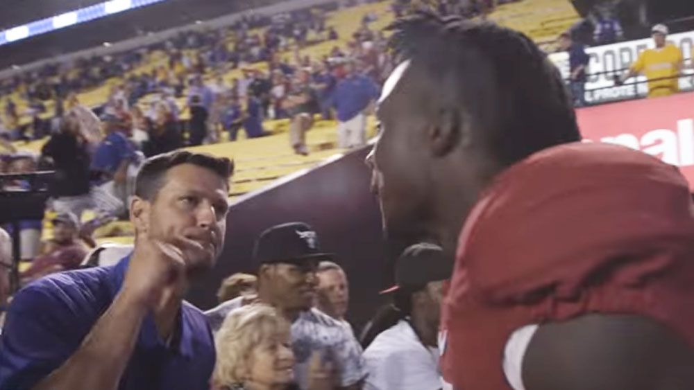Aggressive fan confronts college player