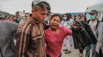 A mother cries as she reunites with her son, who survived from a boat's sinking in Lake Toba, in North Sumarta. Picture: EPA