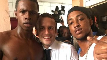 French President Emmanuel Macron has come under attack from far-right leader Marine Le Pen over a photograph taken during his visit to the Caribbean last week.  The photo emerged on social media showing Macron with the two young men, one of whom made a rude gesture; the other has a prior conviction.