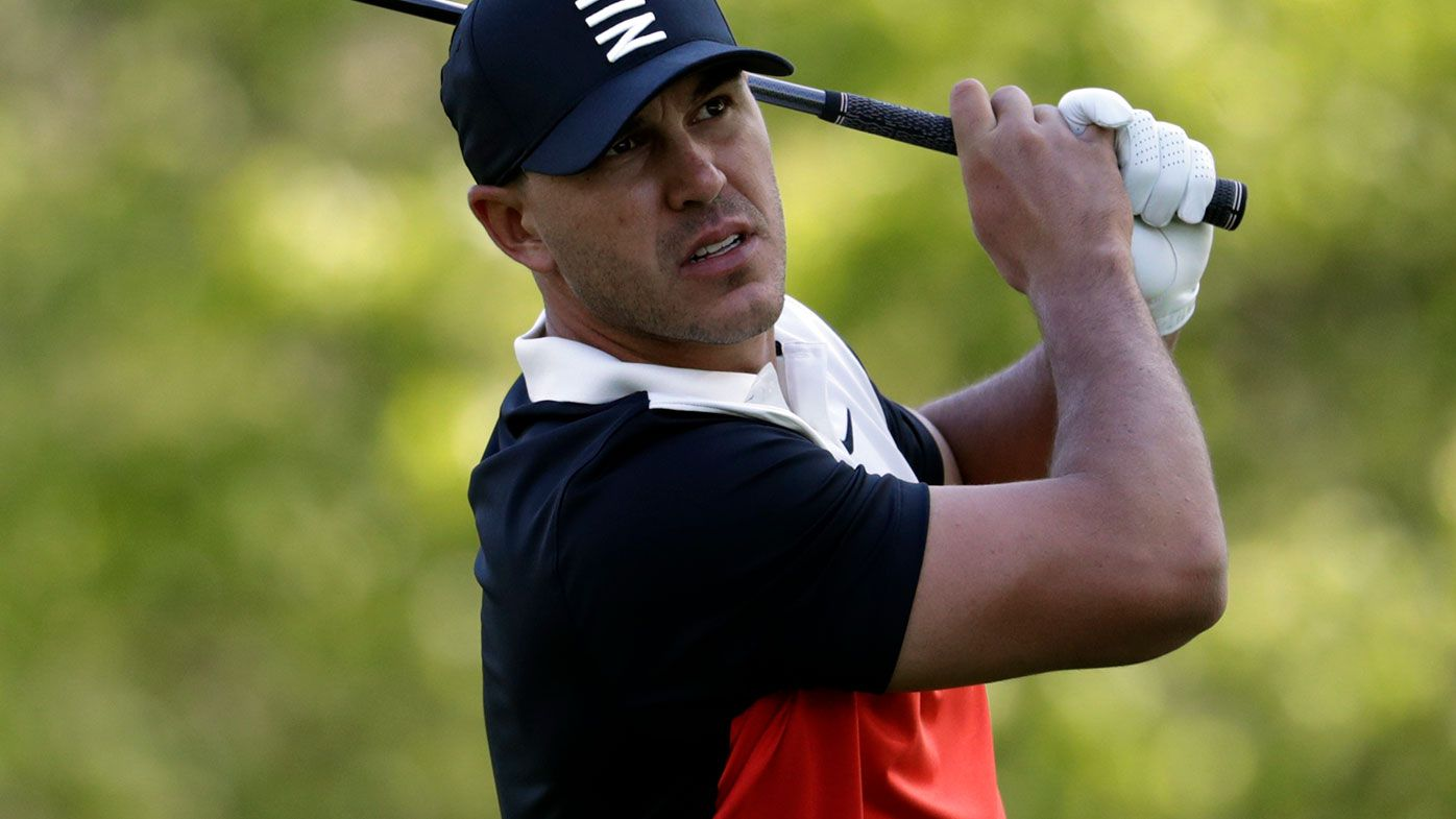 Koepka leads, Woods labours at PGA major