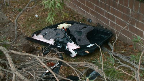 Debris and car parts at the scene of the crash in south-west Sydney. (9NEWS)