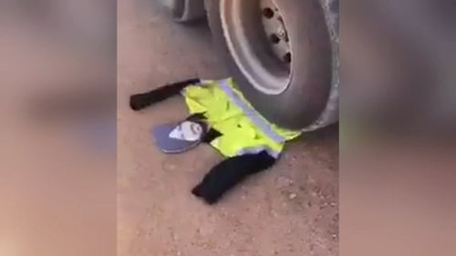 The corflute eventually ended up under the truck's wheels.