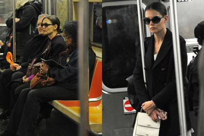 Oversized sunnies on? Check. All black attire? Yep. Public transport scowl? Well done Katie. You almost had us fooled.