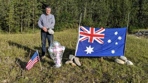 Whitehorse trucker Ed Grennan couldn't stand to leave the spot where Lucas Fowler and Chynna Deese were murdered empty. So he returned with a floral cross and a flag for each victim.