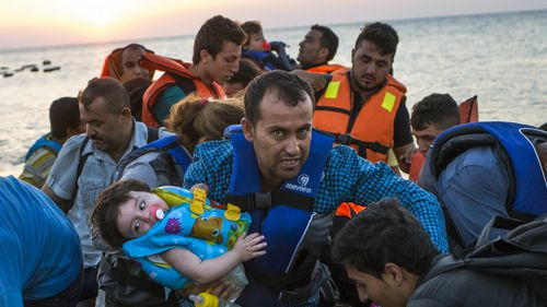 Syrian migrants crossing the Mediterranean Sea from Turkey to the Greek island of Kos. (AAP)