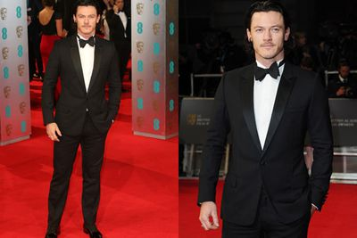Luke Evans looks stern on the red carpet.