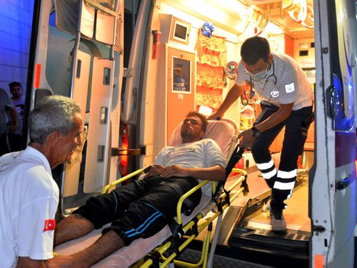 Paramedics carry a person rescued from a boat that capsized off Cyprus' northern coastline, as he is brought to a hospital in Silifke, near the city of Mersin, southern Turkey. Photo: AP