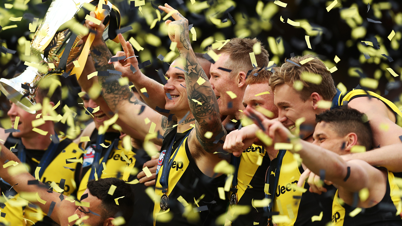 *APAC Sports Pictures of the Week - 2019, September 30* MELBOURNE, AUSTRALIA - SEPTEMBER 28: Dustin Martin of the Tigers holds aloft the Premiership Trophy after victory in the 2019 AFL Grand Final match between the Richmond Tigers and the Greater Western Sydney Giants at Melbourne Cricket Ground on September 28, 2019 in Melbourne, Australia. (Photo by Mark Metcalfe/AFL Photos/via Getty Images )