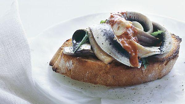 Marinated sardines on toast with piquillo pepper vinaigrette