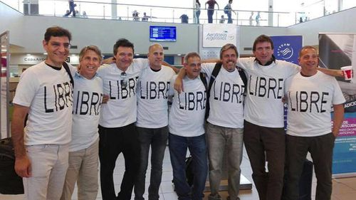 Wearing shirts with the Spanish word for 'free' are Argentinian friends Hernan Ferruchi, Alejandro Pagnucco, Ariel Erlij, Ivan Brajckovic, Juan Pablo Trevisan, Hernan Mendoza, Diego Angelini and Ariel Benvenuto, before their trip to New York City. (AAP)