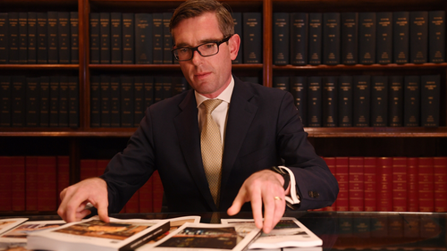 NSW Treasurer Dominic Perrottet looks over the 2019/20 budget papers.