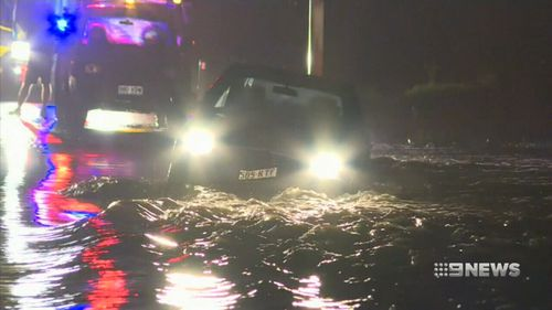Cars were caught in floodwaters as heavy rain lashed south east Queensland. (9NEWS)