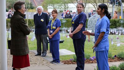 Princess Anne speaks to NHS workers and frontline staff from Wotton Lawn Hospital to thank them for their work during the pandemic