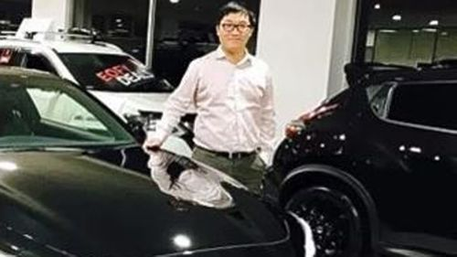 """Bo """"Nick"""" Zhao at his car dealership."""