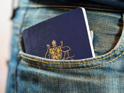 Australian passport in jeans pocket, close up.