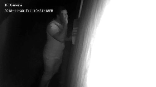 Police have released images of a man after a camera captured him peeping through the window of a house.
