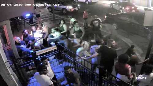 CCTV shows people beginning to flee from the sound of gunshots fired by Connor Betts. Betts killed nine people, including his sister, and injured 26 others in Dayton, Ohio.